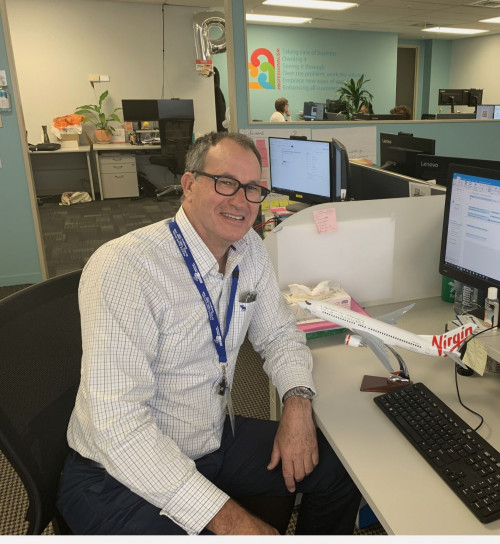 Christian Rush at his desk at HBDHB